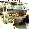 Salvage Chief,Patched  And Raised Stern Of  Tanker  Sansinea,1977 Preparing To Tow To Scrap Yard,Leaving Berth 46,Los Angeles Harbor,Pictured On Wreck Don Floyd Left,